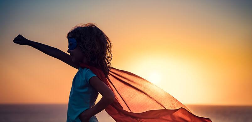 Girl-In-Hero-Pose-On-Beach