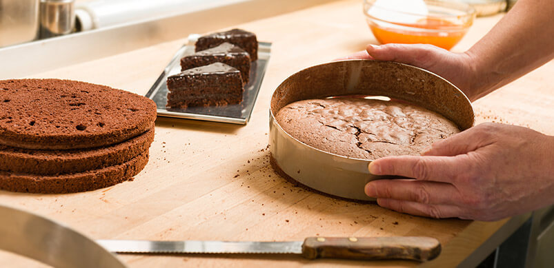 Person-Baking-Chocolate-Cakes