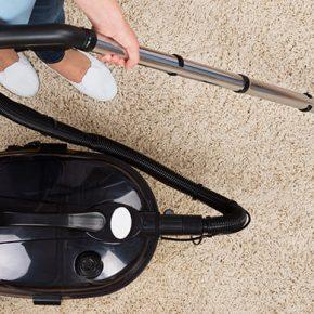 Person-Vacuuming-Cream-Carpet